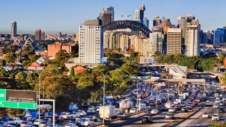 A photograph of Sydney City on a sunny day, looking towards the Sydney Harbour Bridge.