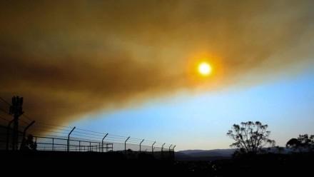 The sun seen through a cloud of smoke.