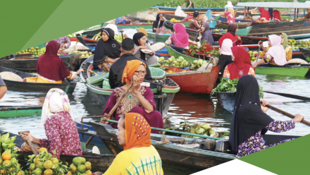 A river filled with boats rowed by women, filled with their farm produce