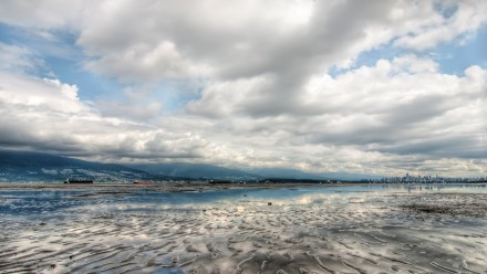 A cloudy sky reflected in a shallow lake