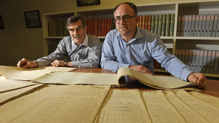 Citizen scie ntist Mac Benoy and SA's National Archives director Nick Gleghorn examining the weather diary at the State Library.