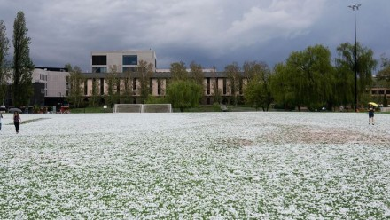 Hailstones cover the soccer pitch at ANU.