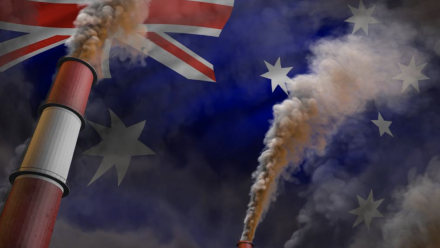 Coal-fired power station chimneys superimposed over the Australian flag.