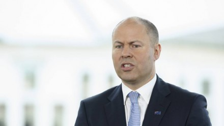 A photograph of Treasurer Josh Frydenberg during a speech in front of Parliament House.