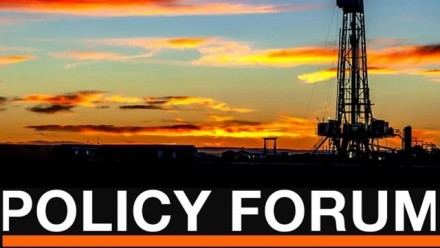 The sun sets behind the silhouette of an oil rig, with the 'Policy Forum' title in large white font at the bottom, and the ANU Asia and The Pacific Policy Society name and logo in the top lefthand corner.