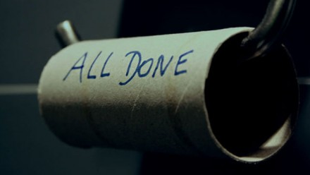 An empty toilet roll, with the words 'all done' written on it.