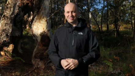 NSW Environment Minister Matt Kean standing in front of an area of bushland