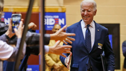 Democratic presidential candidate Joe Biden shaking hands with people during a campaign rally in March.