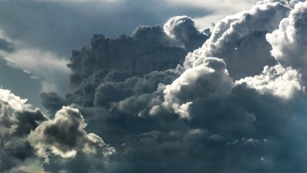 A photograph of building storm clouds.
