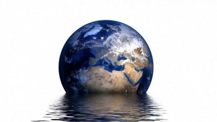 An artistic depiction of a globe being flooded by water.