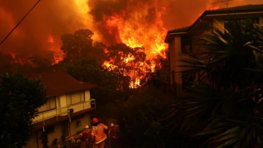 Firefighters tackle blazes approaching homes