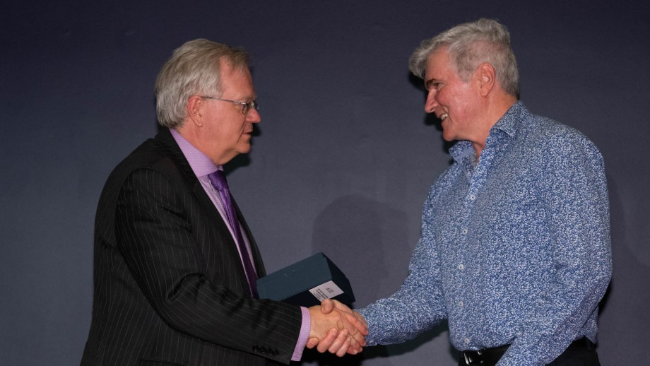 Professor Brian Schmidt, ANU Vice Chancellor, presenting an award to Professor Mark Howden