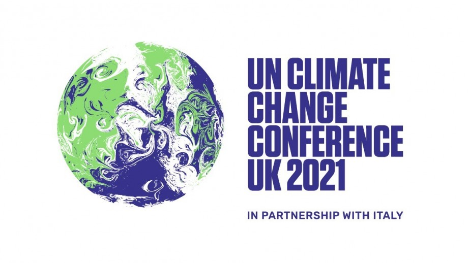The logo for the UN Climate Change Conference UK 2021, with an artistic depiction of the globe on the left-hand side, with the green representing the land, the blue representing the sea, and the white representing the clouds all swirling together.
