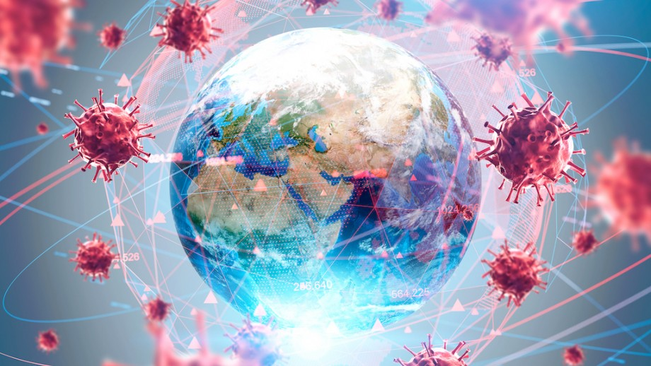 An artistic illustration of the globe, with coronavirus particles floating around it.