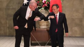 Scott Morrison and Japanese PM  Yoshihide Suga elbow-bump in greeting.
