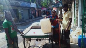 A woman in Bangladesh buys water, a new experience in previously water-abundant Bangladesh, where salt water intrusion is affecting water sources