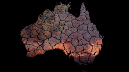 An artistic depiction of a satellite image of the whole of Australia covered in dry, cracked earth