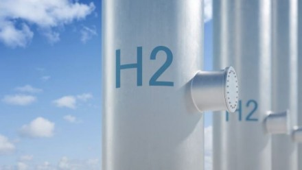 A photograph of a pole with 'H2' written on it, with a blue sky behind.