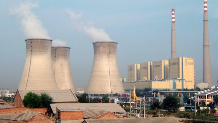 """A photograph of a coal fired power plant near one of Beijing's """"Ring Roads""""."""