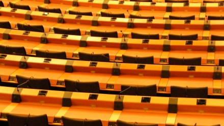 An image of empty seats in the EU Parliament.