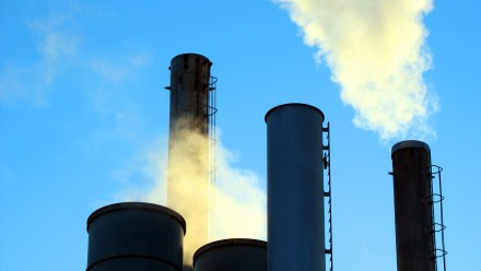 Smoke billowing out of industrial chimneys