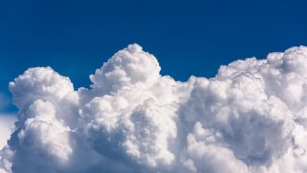 Fluffy clouds in a blue sky.