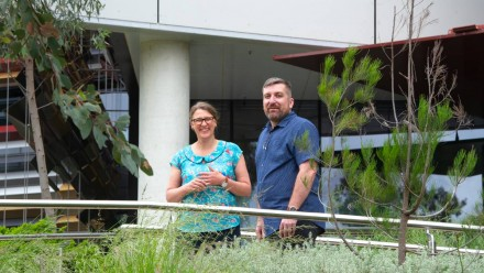 A photograph of Monica van Wensveen and Steven Crimp, standing outside and smiling towards the camera.