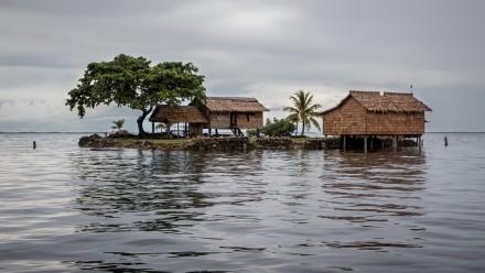 Thatched houses artificial islanda Solomon Islands, Shutterstock