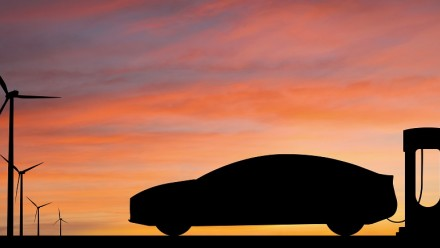 Sunset, wind turbines and electric car, Shutterstock