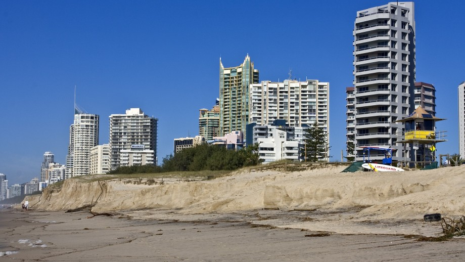 A photograph of sky rise towers at Surfers Paradise, with coastal erosion bringing the beach up within metres of the buildings.
