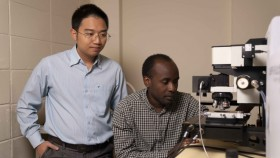 A photograph of Dr Hieu Nguyen and PhD candidate Mike Tebyetekerwa in the lab.