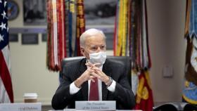 US President Joe Biden seated at a desk