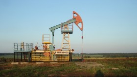 A photograph of an oil reserve in a field in Russia